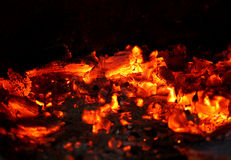 Live coals. Hot coals on a black background Stock Photography