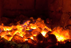 Live coals. Bright live coals smouldering in the stove Royalty Free Stock Images