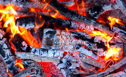 Live Coals. Photo of hot sparking live-coals burning in a barbecue Royalty Free Stock Photography