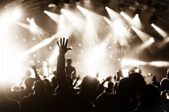 Live concert. Sepia toned crowd cheering at a live music concert Stock Image
