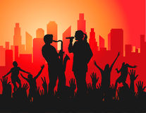 Live Concert in the City. Image of people attending and singing at a music concert in the city Stock Images