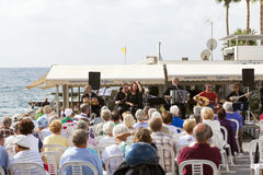 Live concert of traditional Cypriot music on the seafront Stock Photo