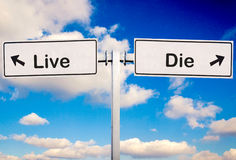 Live or die. Sign over the sky stock photography