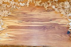 Live Edge Wood Slab with Wood Shavings stock images