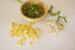 Live  flakes. Ecology concept: Wheat germs in a bowlwith green bamboo Stock Images