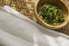 Live  flakes with parsley on served eco table Royalty Free Stock Photography