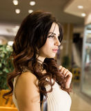 Live fully. Nice beautiful young woman shopping while walking through the mall.  Royalty Free Stock Image
