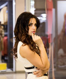 Live fully. Nice beautiful young woman shopping while walking through the mall. girl looks in a shop window Stock Image