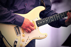 Live guitar player. Old guitar player performing live on stage stock images