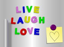 Live laugh love. Fridge magnets spelling live laugh love with a heart drawn on a sticky note royalty free illustration