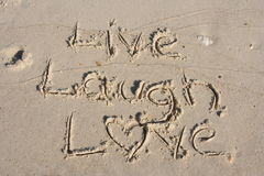 Live Laugh Love. Live, laugh, love in the sand stock image