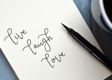Free LIVE LAUGH LOVE Hand-lettered In Notepad Royalty Free Stock Photography - 120021607