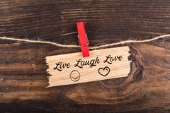 Live laugh love. Write in break wood with clothes pin and rope on wood Royalty Free Stock Photo