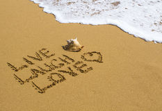 Live, Laugh, Love - Message on the Beach Royalty Free Stock Photos