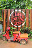 Live Laugh Love and red scooter at Kantang Railway Station Royalty Free Stock Image