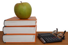 Live and learn. Book, apple, calculator, glasses and pen Royalty Free Stock Photos