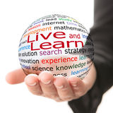 Live and learn. Transparent ball with inscription Live and learn in a hand Royalty Free Stock Photography