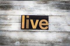 Live Letterpress Word en fondo de madera imagenes de archivo