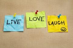 Live, lieben Sie, lachen Sie - Anzeigenanmerkungen Stockbilder