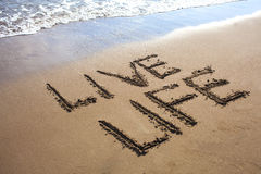 Live Life. Written  on a beach Stock Images