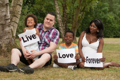 Live love forever. African multicultural family is holding white boards royalty free stock photography