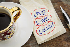 Live, love, laugh. Motivational words - a napkin doodle with a cup of espresso coffee Royalty Free Stock Photography