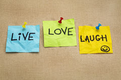 Live, love, laugh - reminder notes. Live, love, laugh - motivational words on sticky note reminders Stock Images