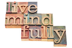 Live mindfully in wood type Stock Photos