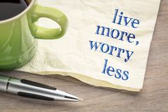 Live more, worry less text on napkin Royalty Free Stock Images