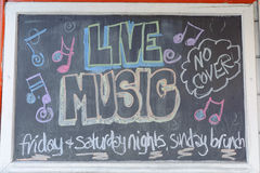 Live music. Inscription on blackboard. May be use like background Royalty Free Stock Photos