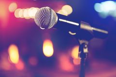 Microphone and stage lights.Concert and music concept Royalty Free Stock Photos