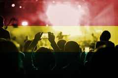 Live music concert with blending Bolivia flag on fans Royalty Free Stock Image