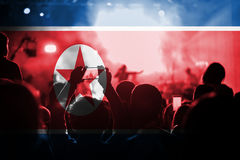 Live music concert with blending DPR Korea flag on fans Royalty Free Stock Images