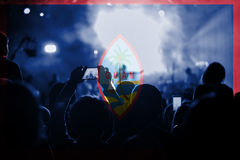 Live music concert with blending Guam flag on fans Royalty Free Stock Image