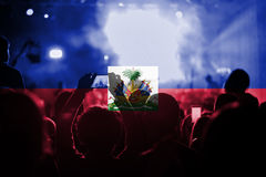 Live music concert with blending Haiti flag on fans stock image