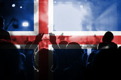 Live music concert with blending Iceland flag on fans royalty free stock photography