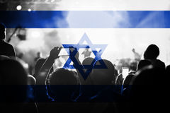 Live music concert with blending Isreal flag on fans Royalty Free Stock Photo