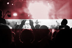 Live music concert with blending Latvia flag on fans stock photography