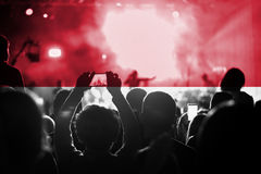 Live music concert with blending Monaco flag on fans royalty free stock photography