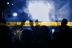 Live music concert with blending Nauru flag on fans Stock Images