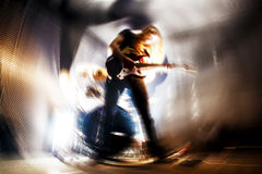 Live music and guitar player.Music instrument. Man playing the guitar.Abstract Live music background concept.Guitar player and rock music concept royalty free stock photo