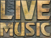 Live music wooden letterpress. Live music label composed from vintage wooden letterpress type royalty free stock photos