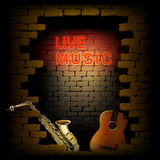 Live music neon light of brick wall saxophone and guitar Royalty Free Stock Photos