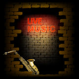 Live music neon light in the doorway of brick wall saxophone Stock Images