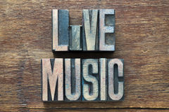 Live music wood. Live music phrase made from wooden letterpress type on grunge wood Stock Photography