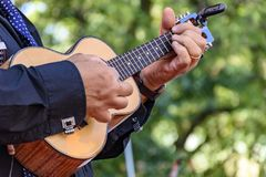 Little four strings acoustic guitar. Live musical performance of Brazilian popular music called chorinho with little acoustic guitar with four strings royalty free stock image