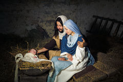 Live nativity scene. Live Christmas nativity scene in an old barn - Reenactment play with authentic costumes. The baby is a (property released) doll royalty free stock photos