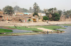 Live on the Nile. Living on the banks of the Nile river. People of a small village are looking for the Nile cruise ships. Foto was taken in april 2007 Royalty Free Stock Images