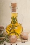 Live oil with spices and garlic Stock Images