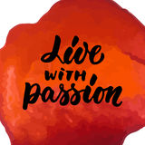 Live with passion - hand drawn lettering phrase isolated on the red watercolor background. Fun brush ink inscription for Stock Photos